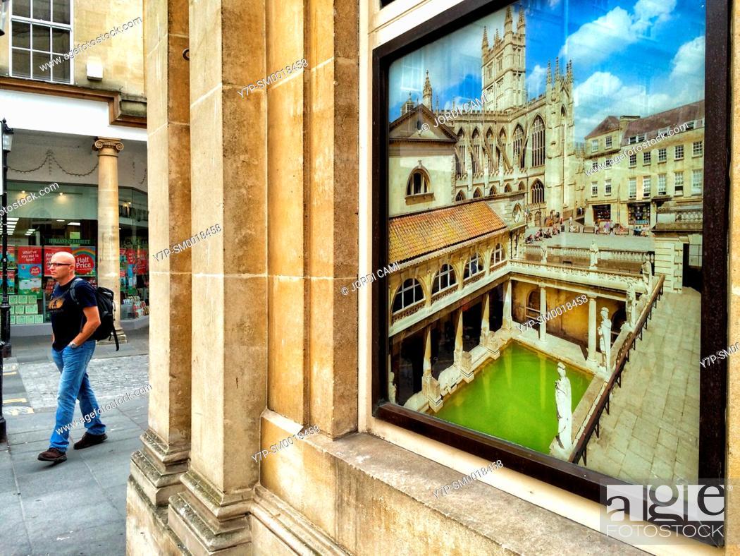 Stock Photo: Photo advertising the Roman Bath on a wall . Bath. Somerset. England. United Kingdom.