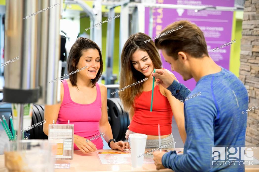 Stock Photo: Friends taking break in gym.