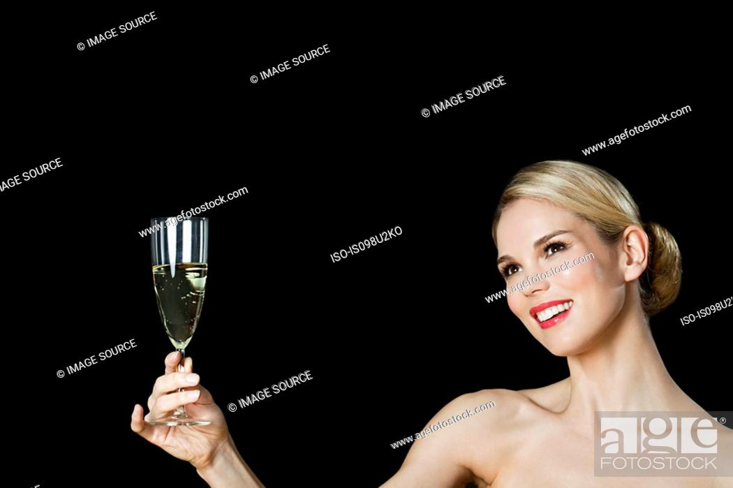 Stock Photo: Young blonde woman with champagne glass.