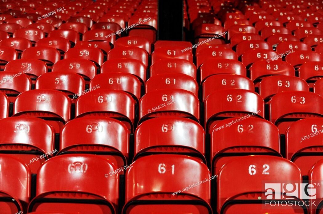 Stock Photo: Red seats at a sports stadium.