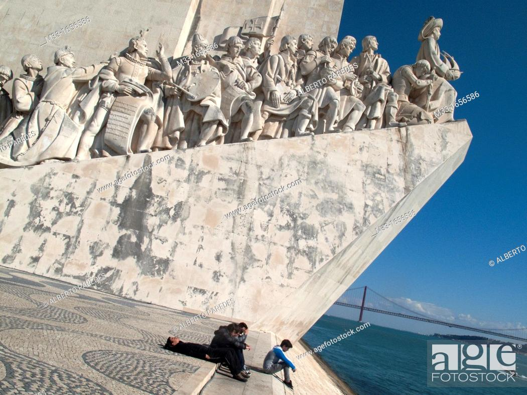 Stock Photo: Monument to the Discoveries and 25 April bridge over Tajo river, Lisbon, Portugal.