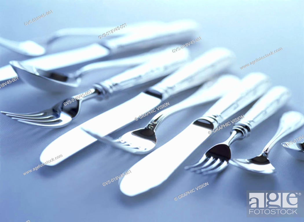 Stock Photo: Close Up of Knives Forks and Spoons.