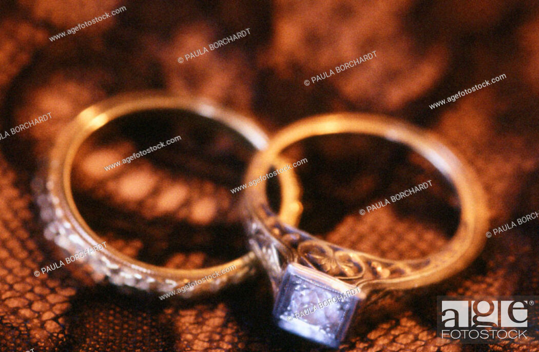 Stock Photo: Antique wedding and engagement rings.