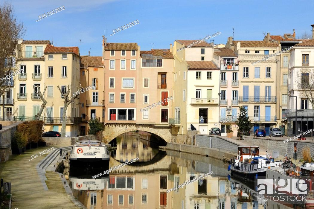 Stock Photo: The Canal de la Robine runs through the center of the city of Narbonne, France.
