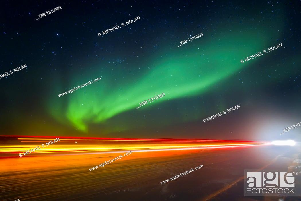 Stock Photo: Aurora Borealis Northern Polar Lights with truckers lights on the ice road outside Yellowknife, Northwest Territories, Canada.