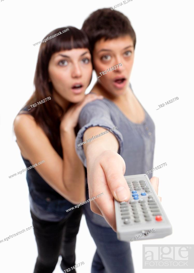 Stock Photo: Two women using remote control.