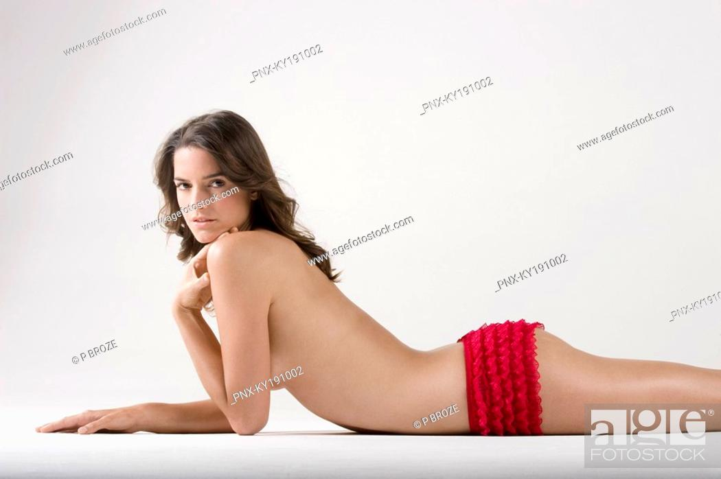 Stock Photo: Portrait of a woman lying on the floor.