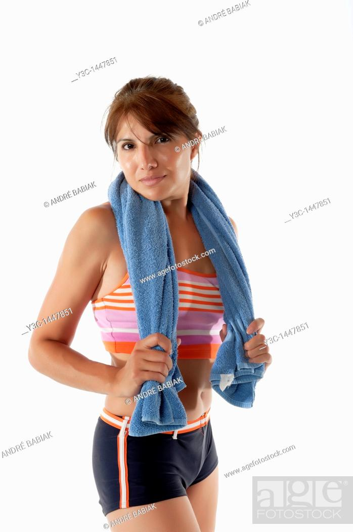 Stock Photo: Woman with towel exhausted after fitness exercise.