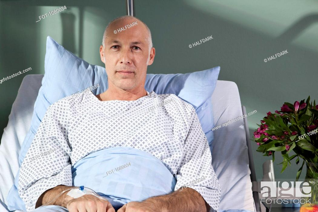 Stock Photo: Portrait of a man in a hospital bed.