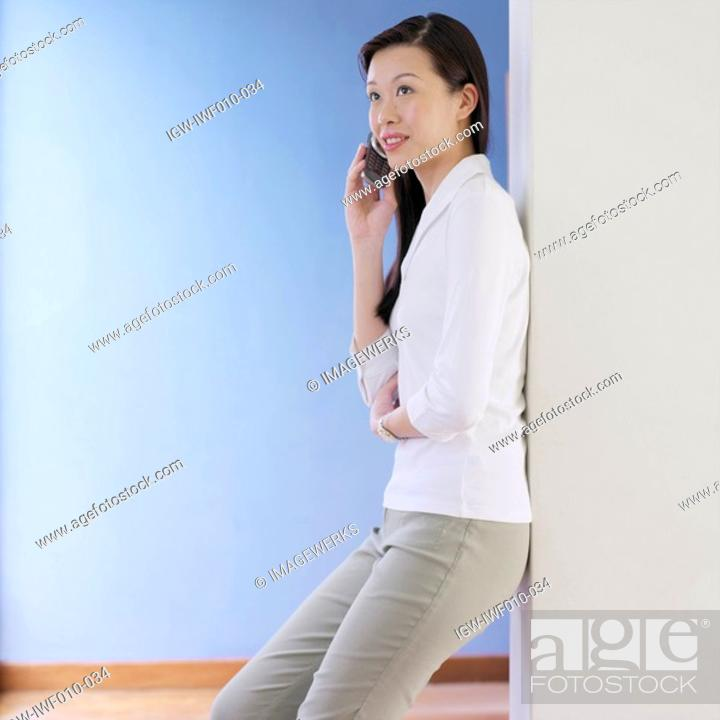 Stock Photo: Young woman talking on a mobile phone.