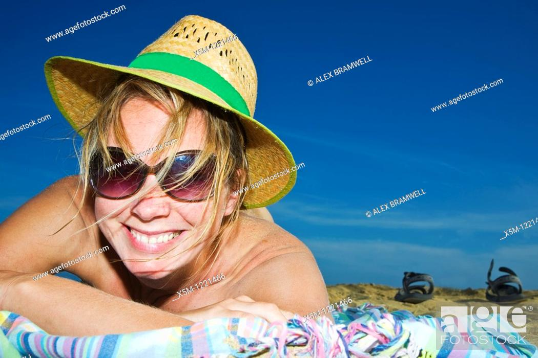 Stock Photo: Woman smiling on the beach.