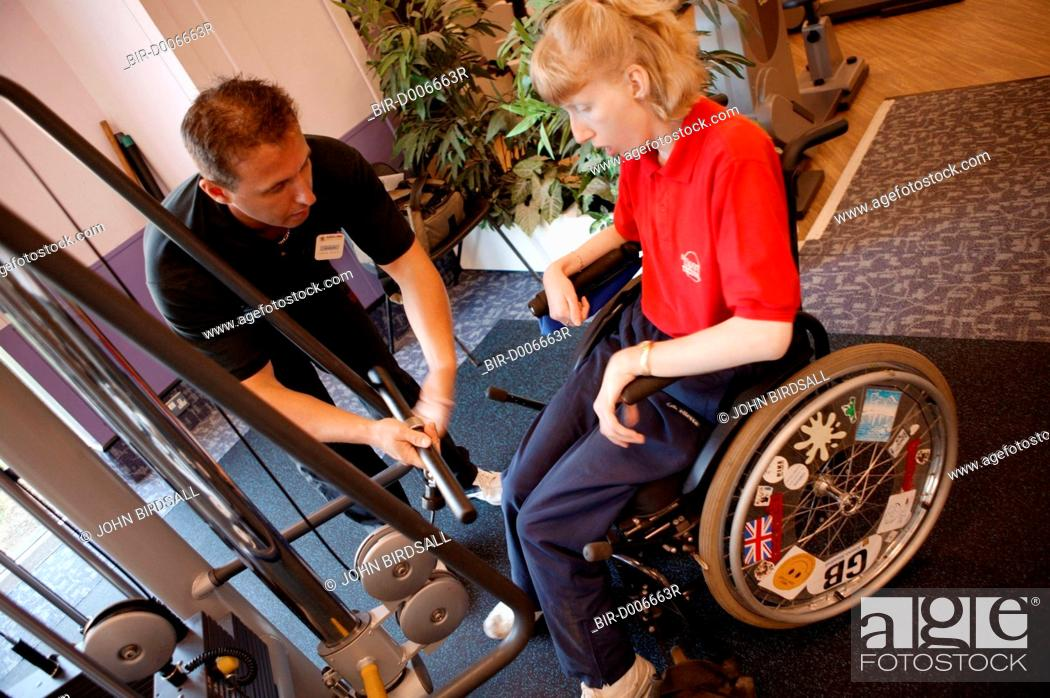 Access to services fitness instructor and disabled woman in the