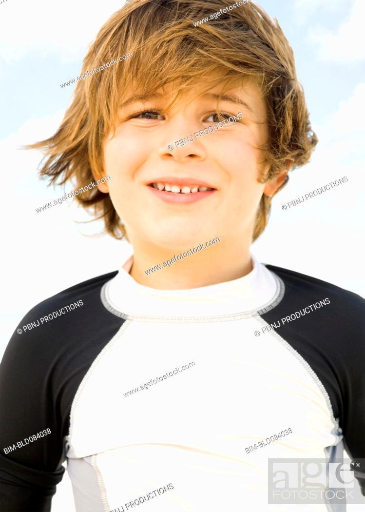Stock Photo: Wind blowing Caucasian boy's hair.