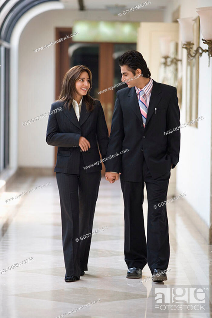 Stock Photo: Businesspeople holding hands.