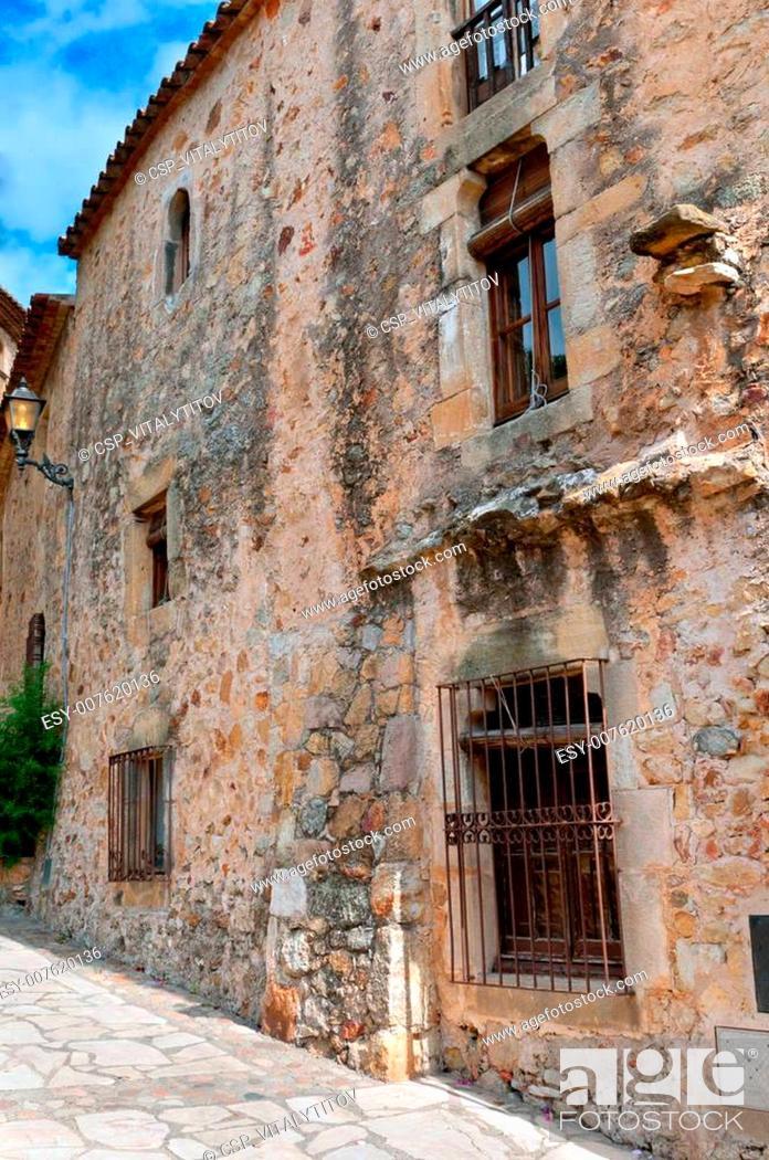 Stock Photo: Old stone wall, Peratallada, Spain.