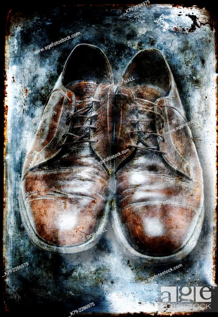 Stock Photo: A pair of mens brown dress shoes appear to be encased in ice.