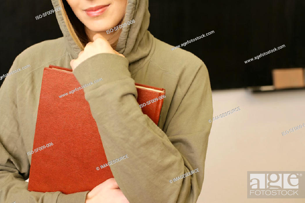 Stock Photo: Young woman in a hooded sweater.