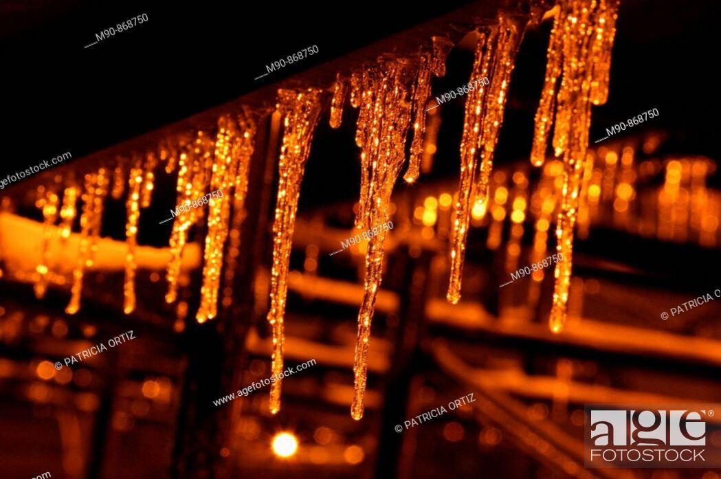 Stock Photo: Ice stalactites at night.