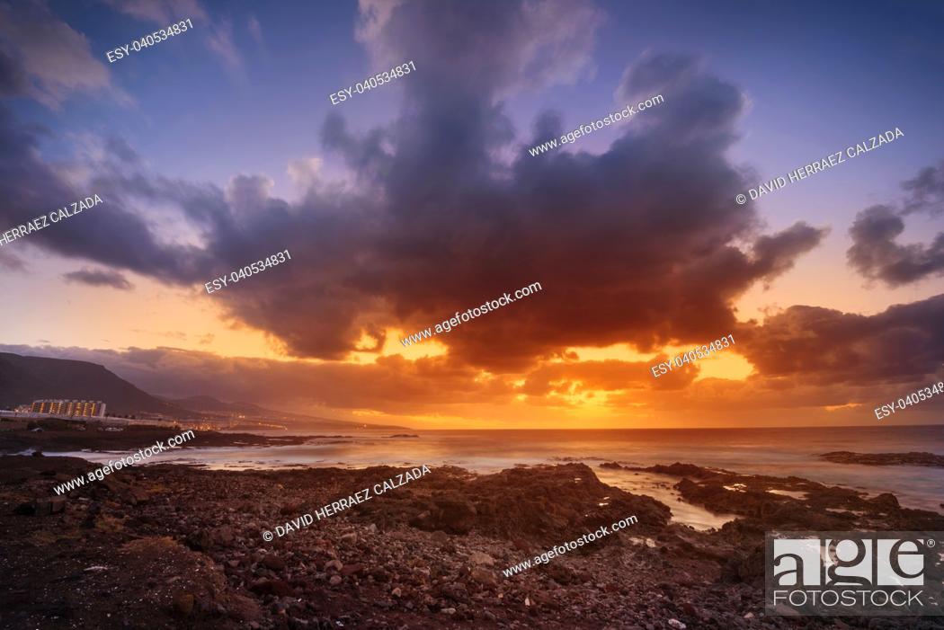 Stock Photo: Sunset in Punta del Hidalgo, north Tenerife coastline, Canary islands, Spain.