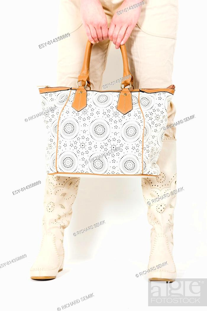 Stock Photo: detail of standing woman wearing summer boots holding a handbag.