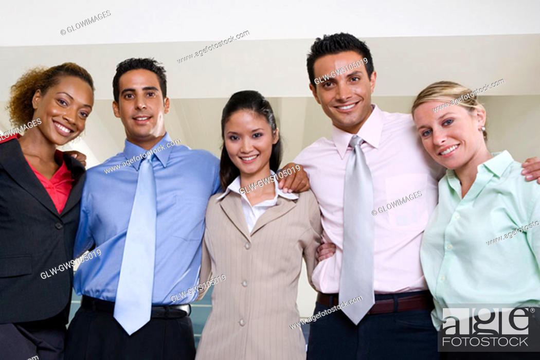 Stock Photo: Portrait of two businessmen and three businesswomen smiling.