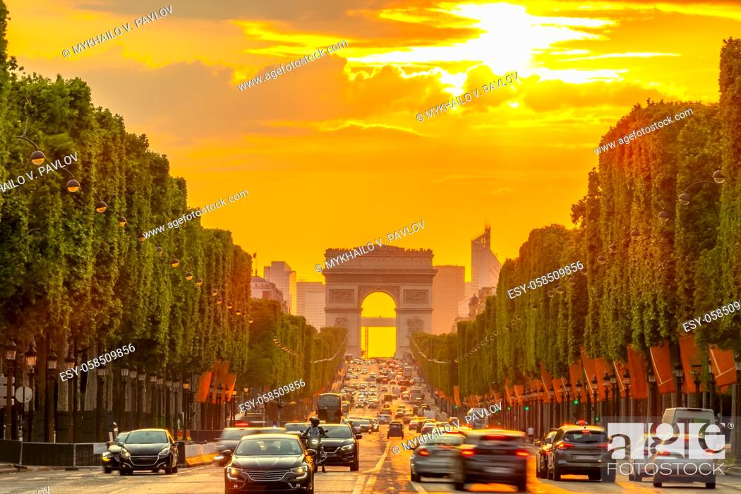 Stock Photo: France. Summer evening in Paris. Traffic on the Champs-Elysees and the Arc de Triomphe. Golden sunset.