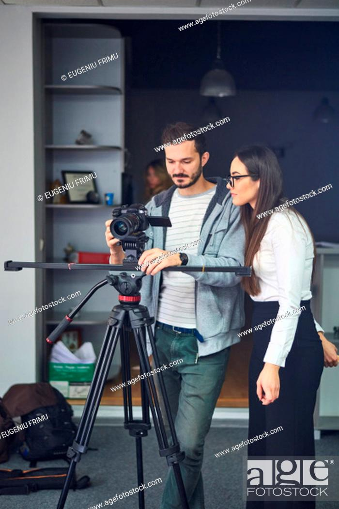 Stock Photo: Cameraman showing the footage to the actor in the office scene backstage.