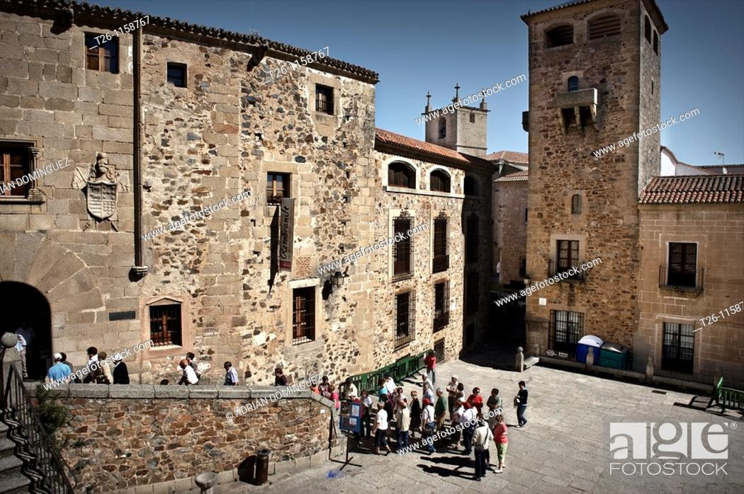 Stock Photo: a group of tourists in the Old Town. Caceres, Spain.
