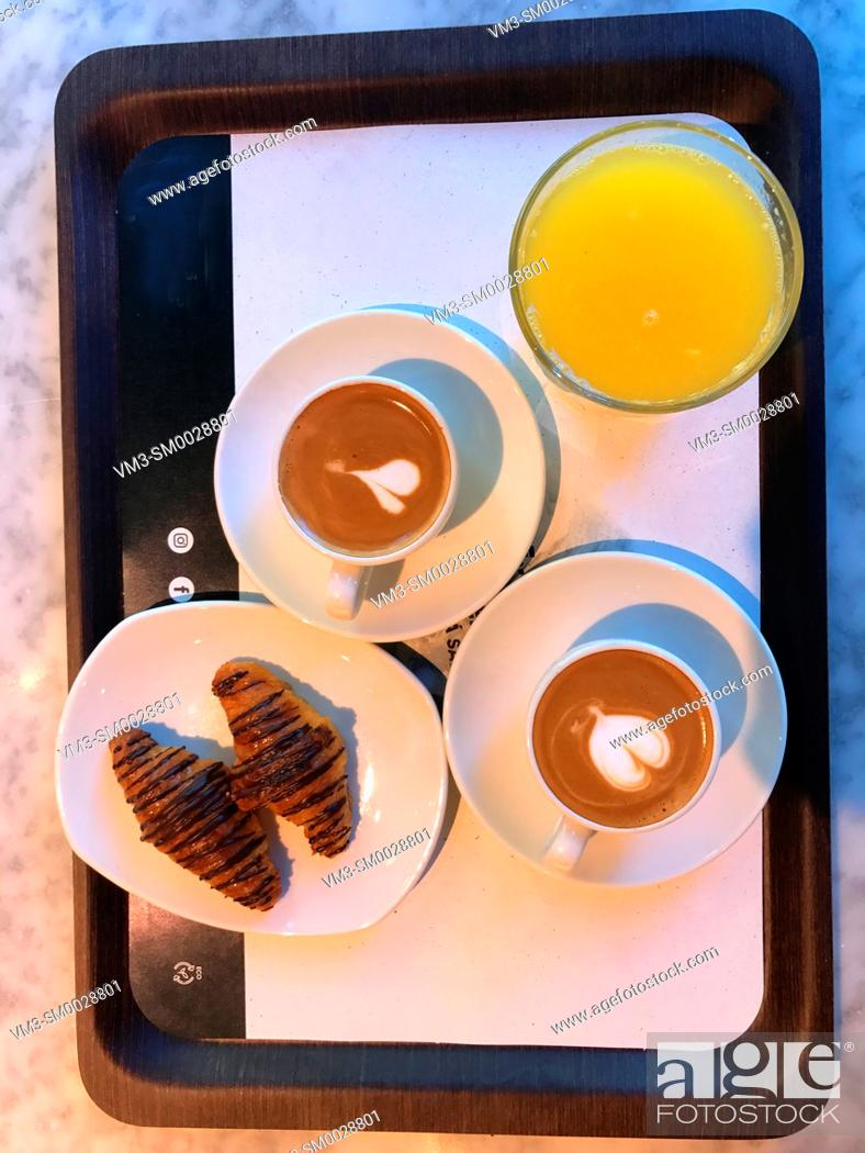 Stock Photo: Two cups of coffee with croissants and orange juice. View from above.