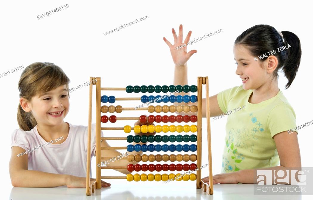 Stock Photo: Girls using abacus.
