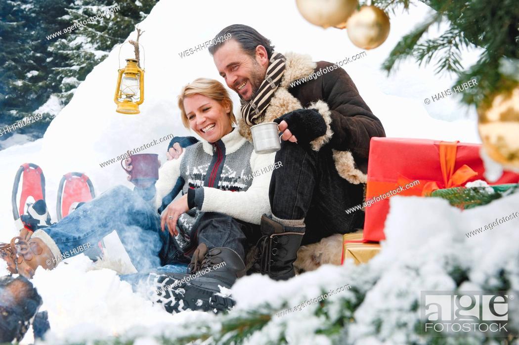Stock Photo: Austria, Salzburg County, Couple celebrating christmas in nature, smiling.