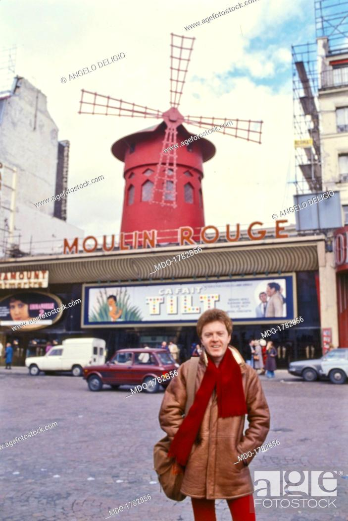 Stock Photo: Italian singer-sonwriter and guitarist Umberto Tozzi posing in front of the Moulin Rouge in the neighbourhood of Pigalle. Paris, 1978.