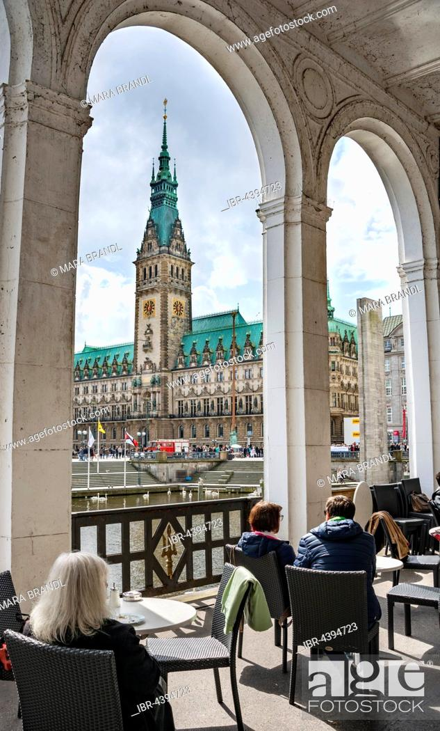 Stock Photo: Cafe in the Alster Arcades overlooking City Hall, Hamburg, Germany.