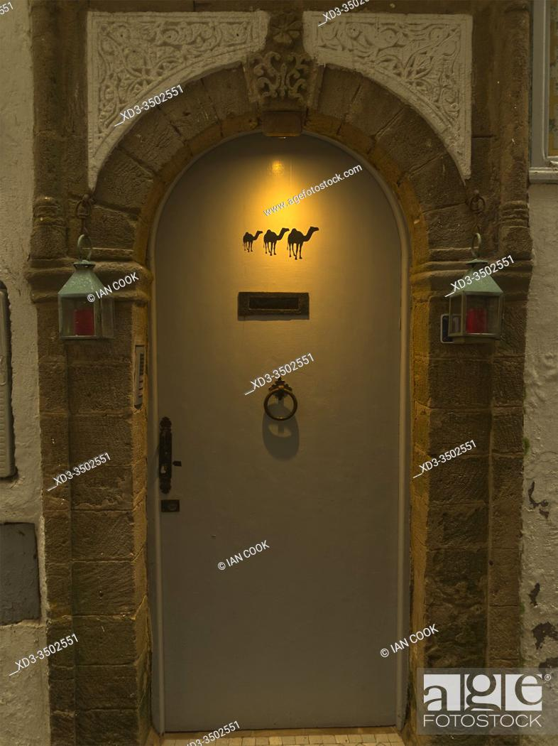 Stock Photo: front door of house with camels painted on it, Essaouira, Morocco.