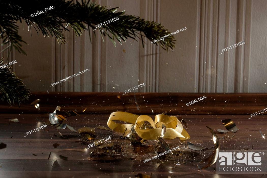 Stock Photo: A Christmas bauble shattering.