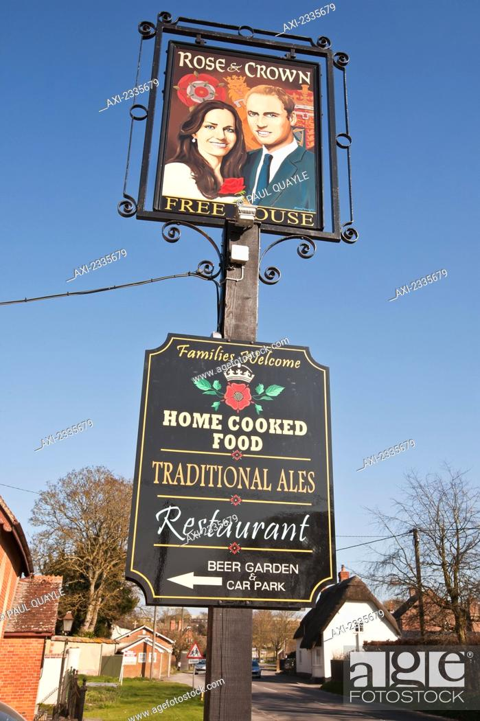 Stock Photo: Prince William and Catherine, Duchess of Cambridge painted on pub sign at High Street; Tilshead, Wiltshire, England, UK.