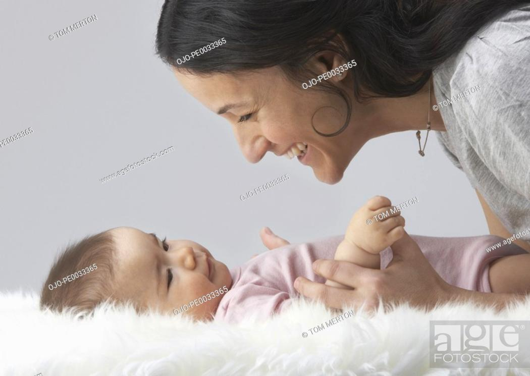 Stock Photo: A woman playing with a baby.