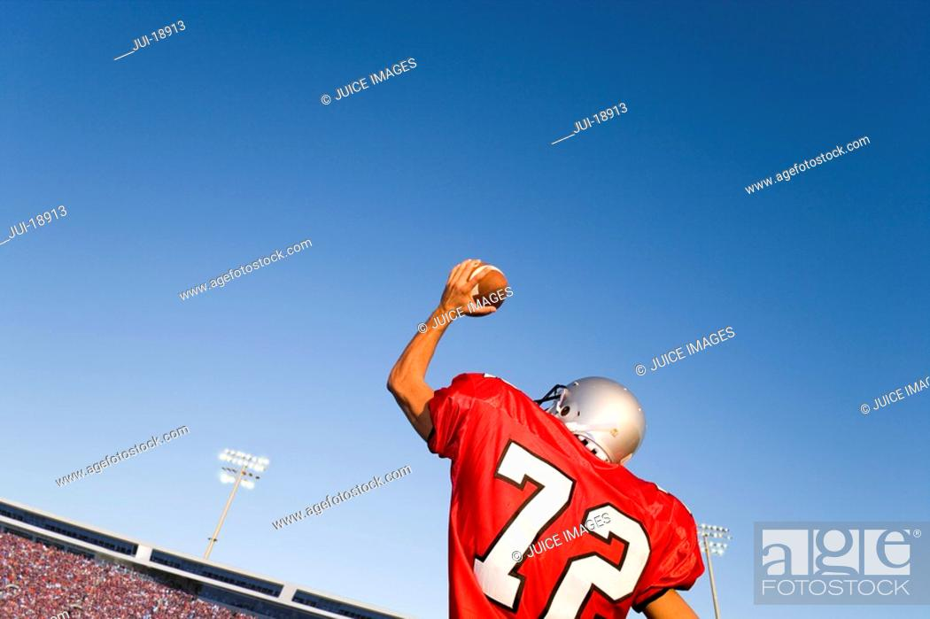 Stock Photo: Quarterback throwing football.