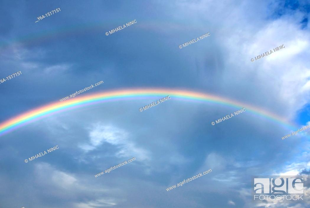 Stock Photo: Rainbow across clouds.