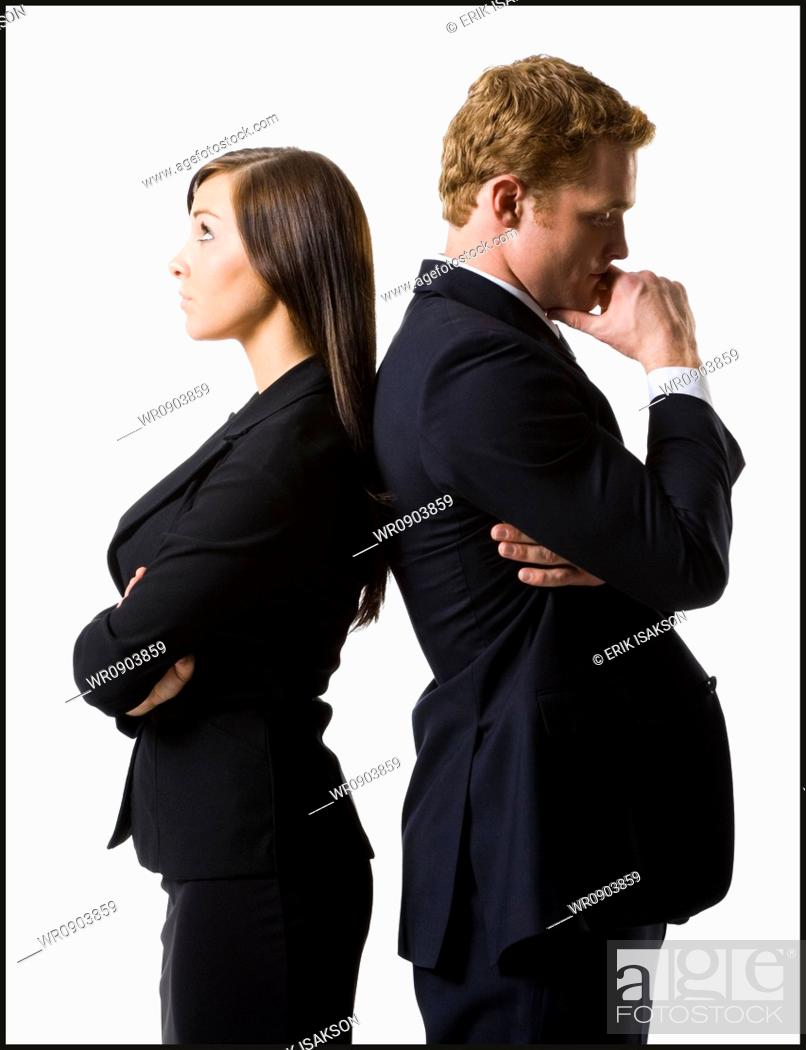 Imagen: Businessman and businesswoman standing back to back.