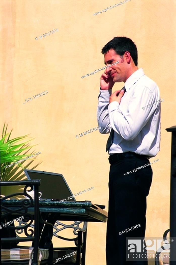 Stock Photo: Businessman using mobile phone.