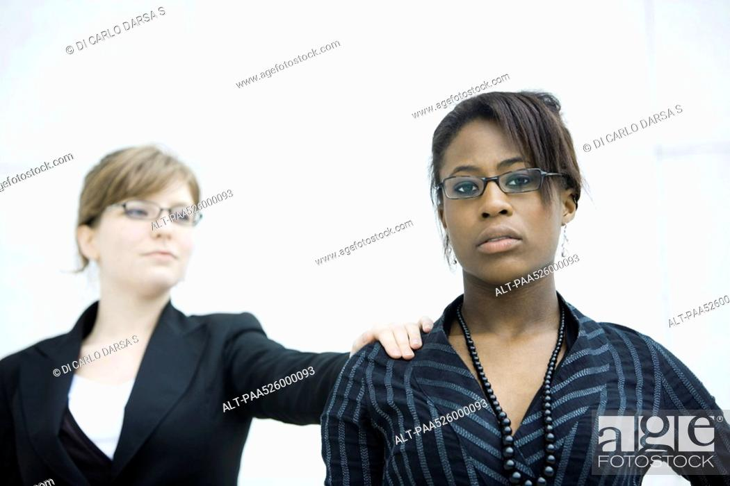 Stock Photo: Businesswoman tapping associate on shoulder.