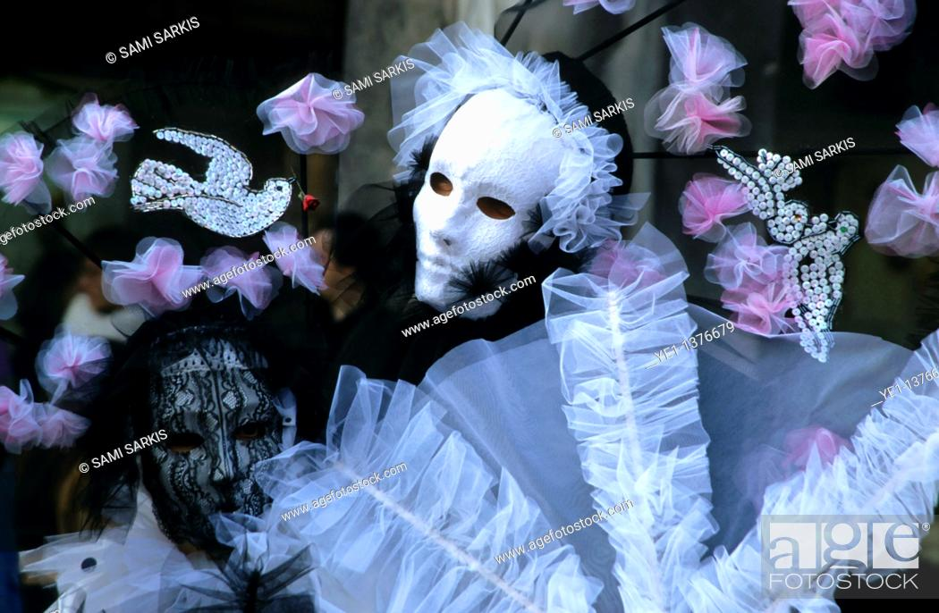 Stock Photo: Portrait of two people wearing Venetian masks and costumes, Venice, Italy.