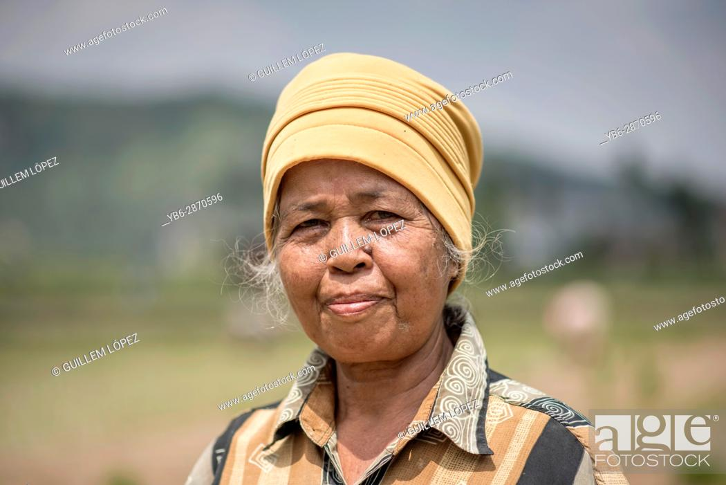 Stock Photo: Portrait of a female rice field worker at the Harau Valley, Sumatra, Indonesia.