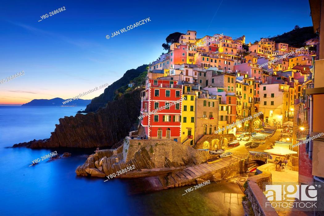 Stock Photo: Riomaggiore at evening dusk, Riviera de Levanto, Cinque Terre, Liguria, Italy.