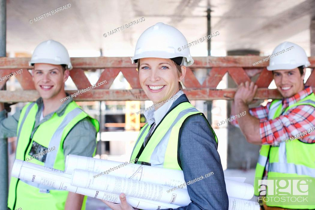 Stock Photo: Construction workers on construction site.