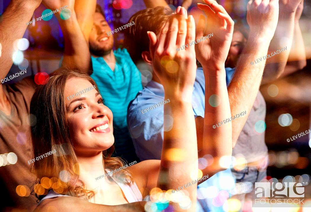 Stock Photo: party, holidays, celebration, nightlife and people concept - smiling friends applauding at concert in club.