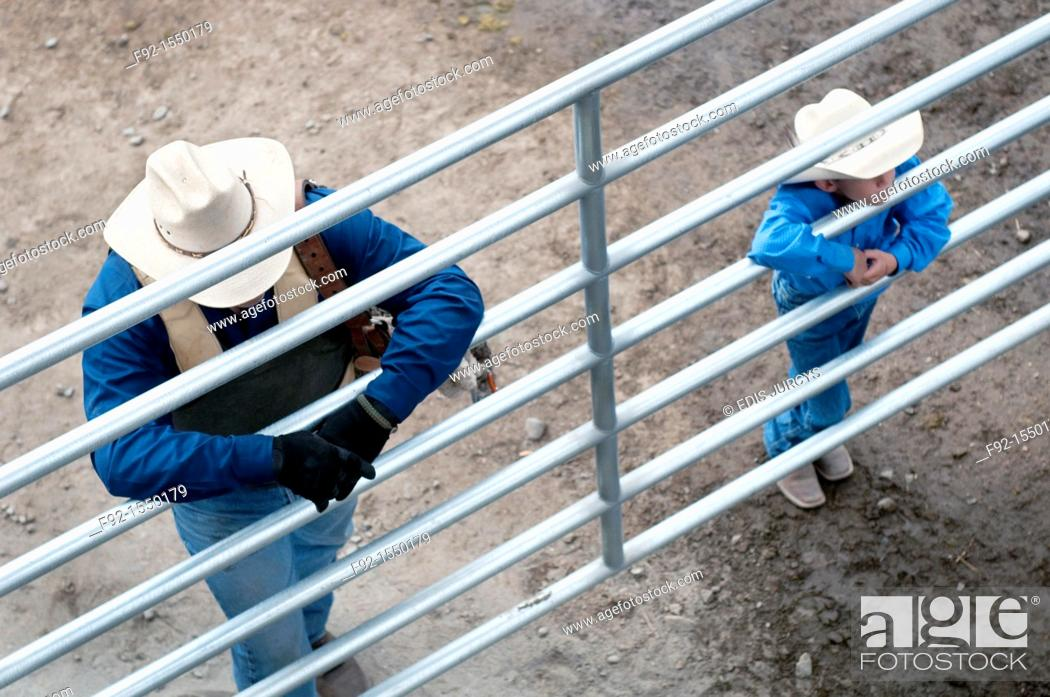 Stock Photo: Father and son watching Rodeo.