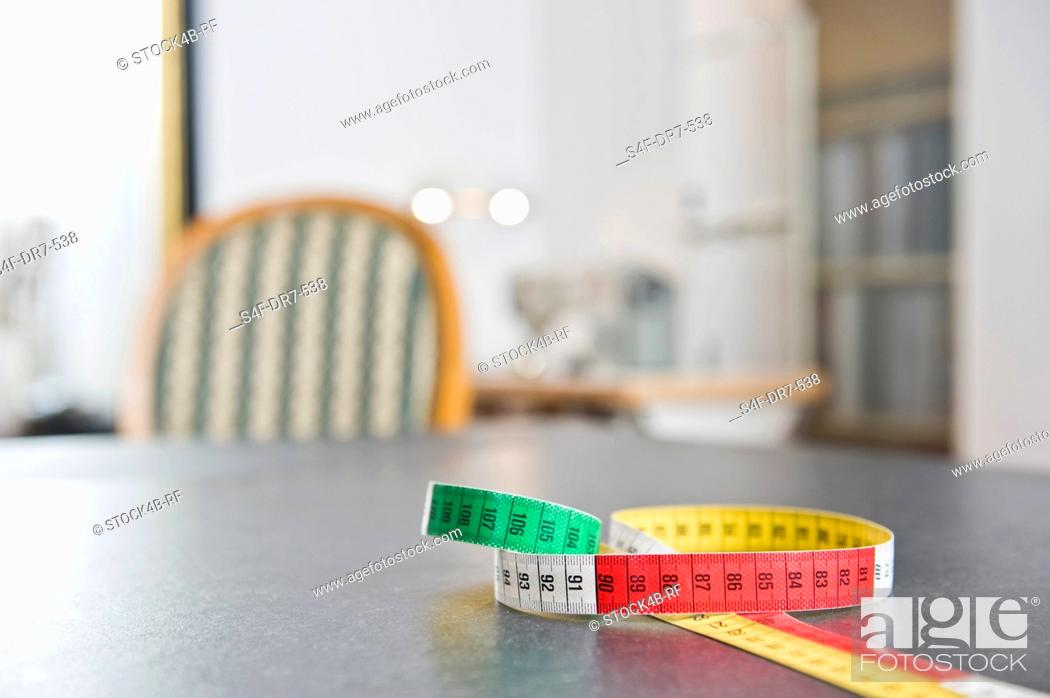 Stock Photo: Tape measure on a table.