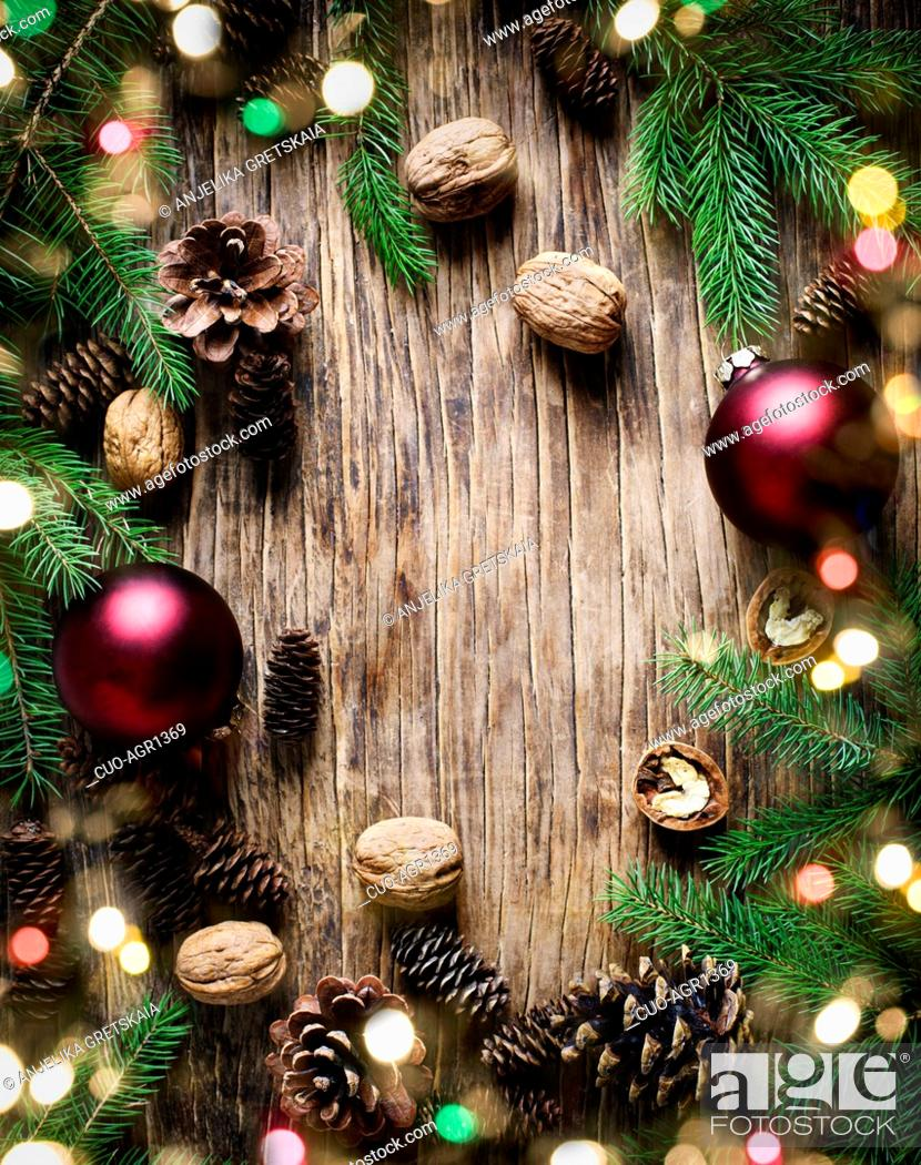 Stock Photo: Christmas holiday background with fir branches, pine cones and nuts. Winter holiday concept composition, copy space.